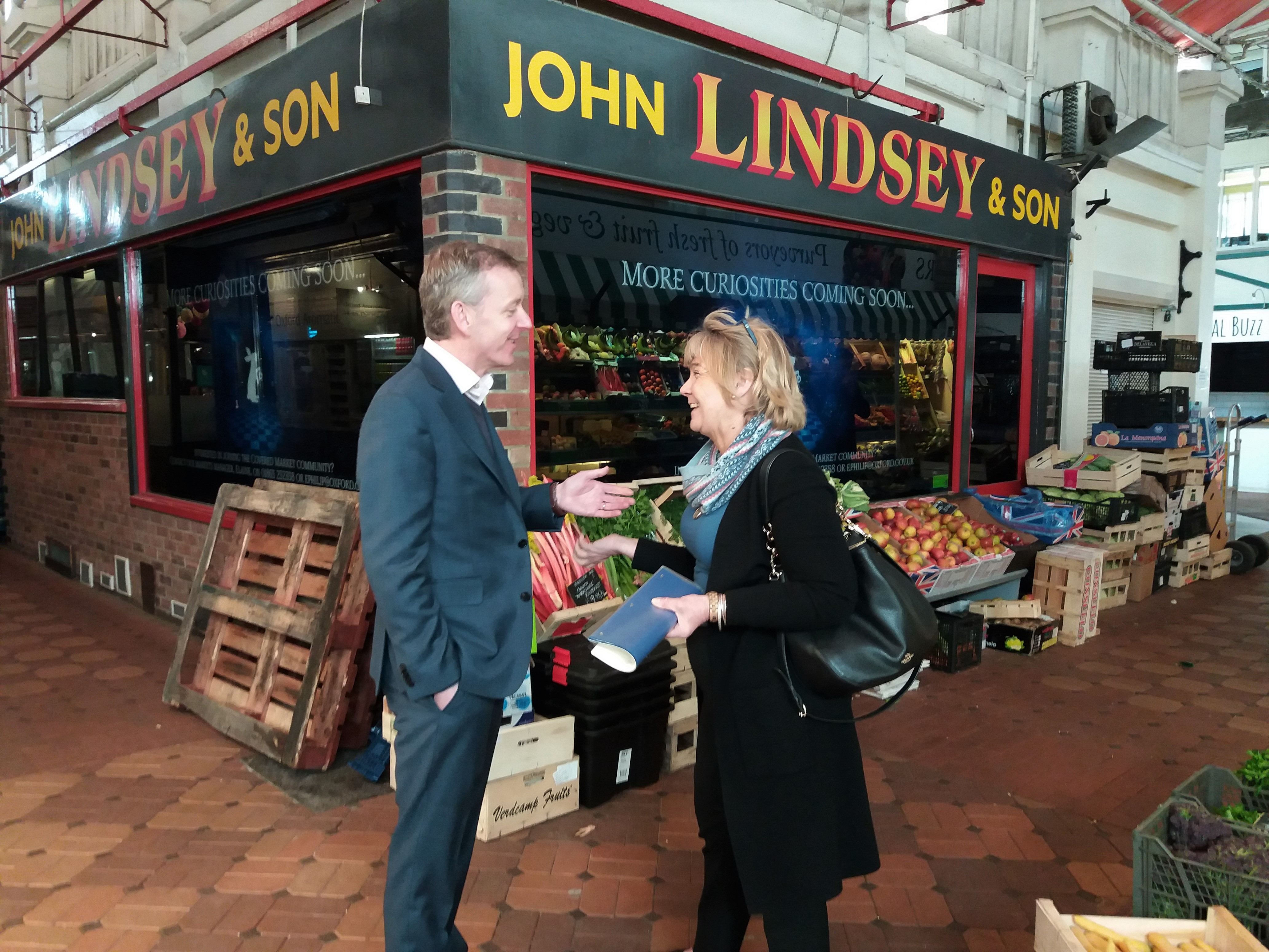Debbie and Tom stand outside the Lindsey'Unit in the Covered Market