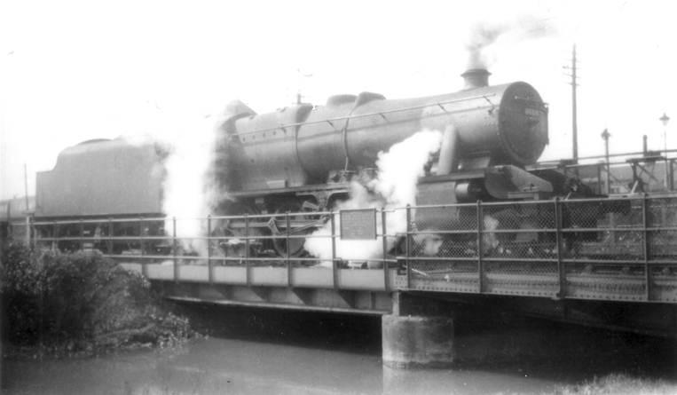 Black and white photo of locomotive reversing over LMS Swingbridge